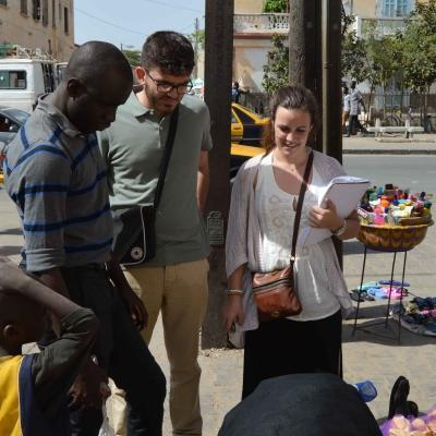 Students talk to a local street vendor during their Human Rights internship in Senegal.